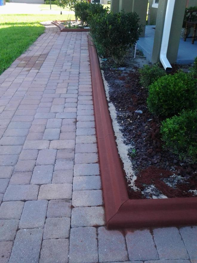 Concrete Landscaping Borders - installed to keep mulch in the flower beds and off the sidewalks.